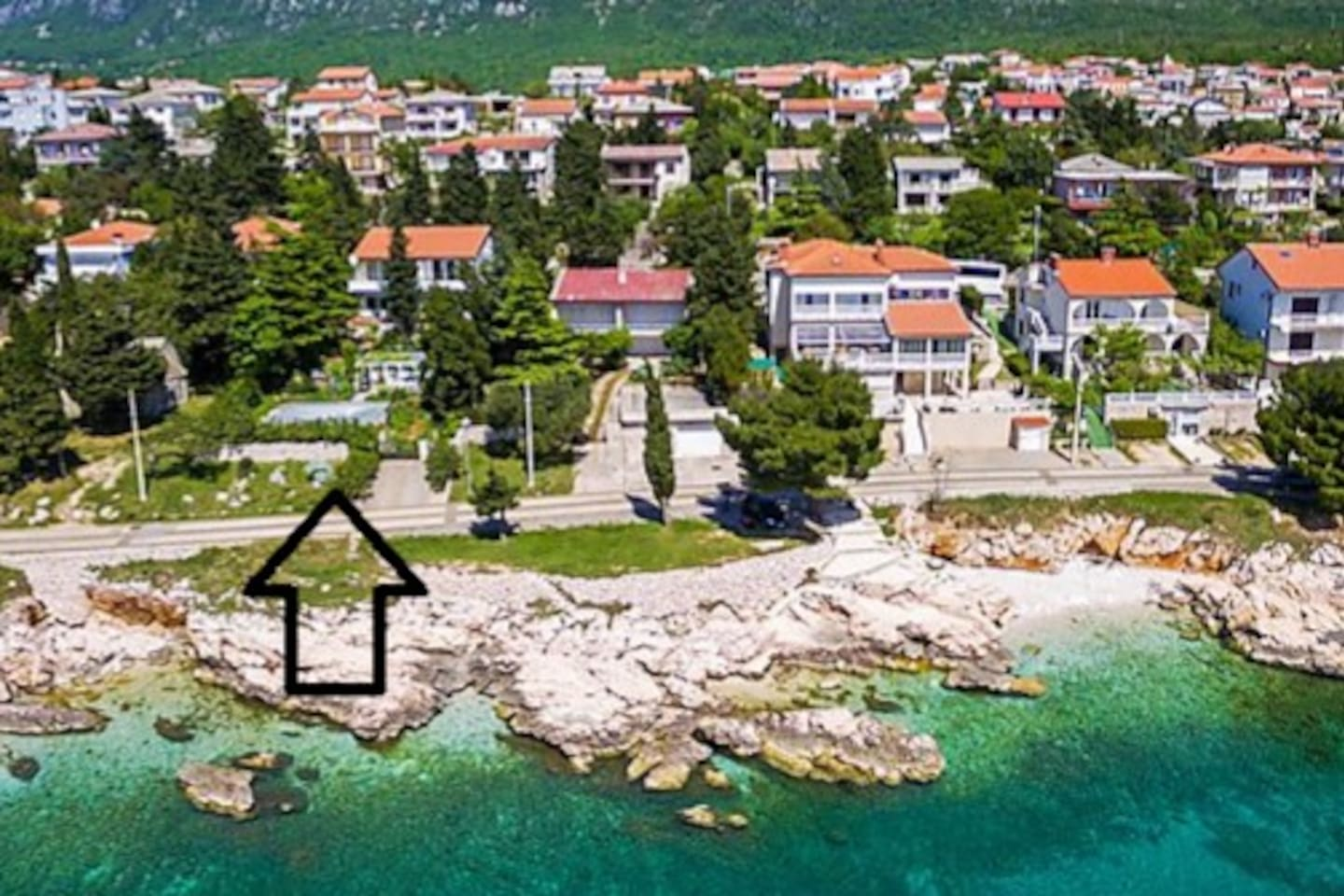 View of our house from the sea. Black arrow shows the entrance to our property.