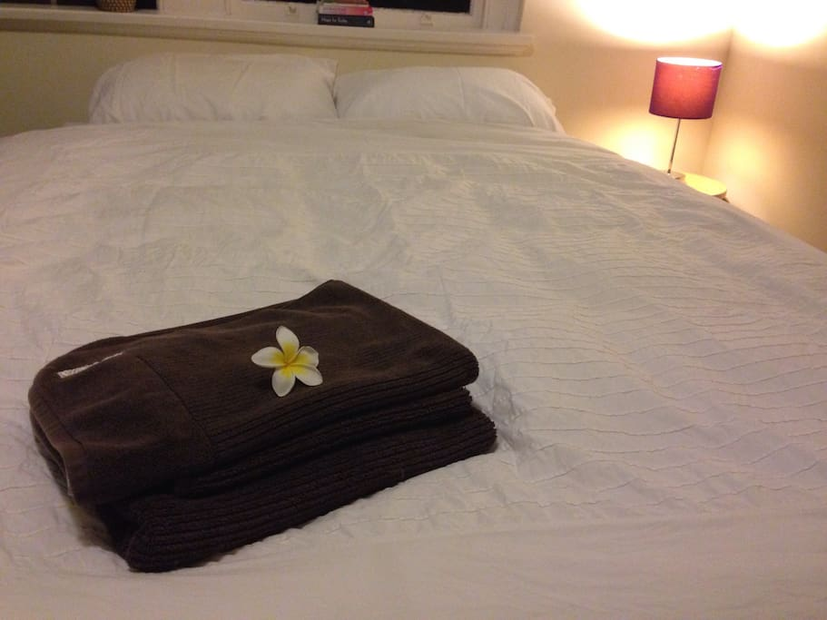 Fresh towels, frangipani from the garden