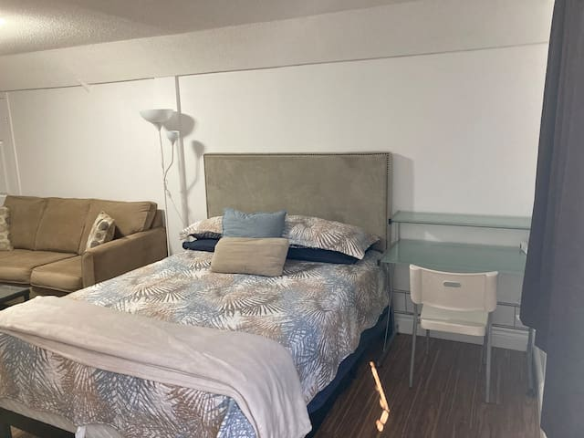 Queen bed and desk