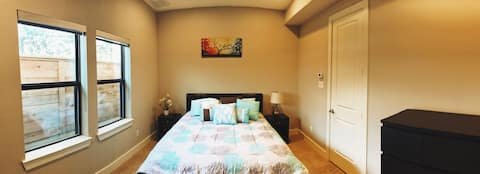 Large spacious room with homey decor.