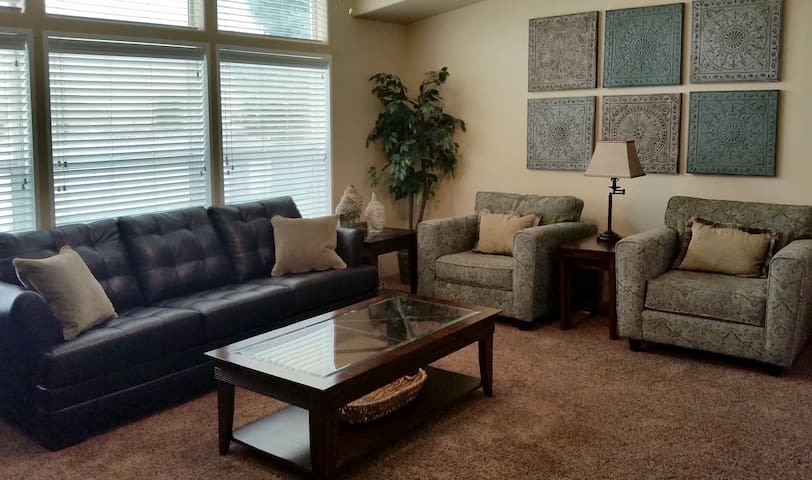 Spacious and attractive living room with memory foam sofa bed and large flat screen cable TV, wifi