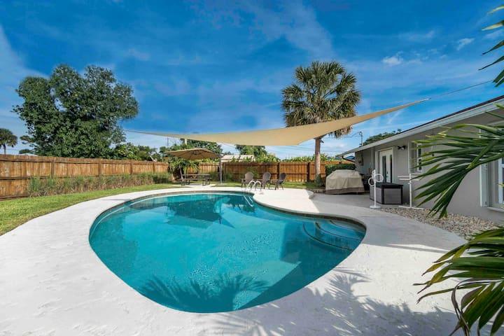 Family friendly home near beach with heated pool!