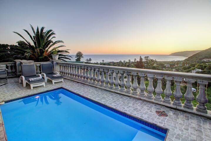 Swimming pool at dawn... splash pool with sun panels