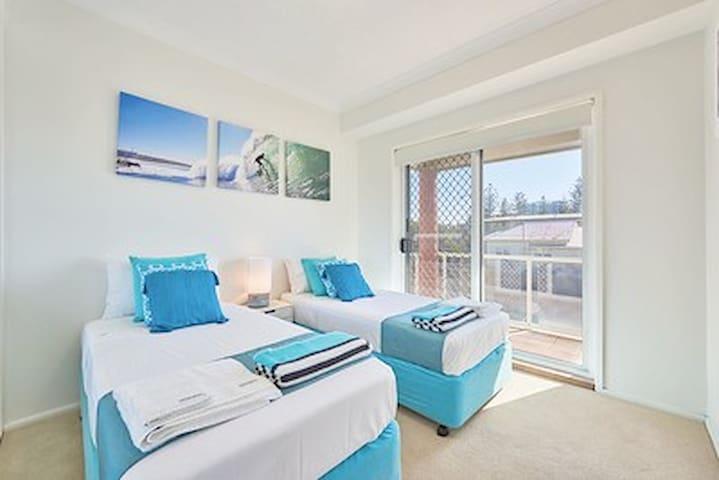 Bedroom 2. Also has a balcony.