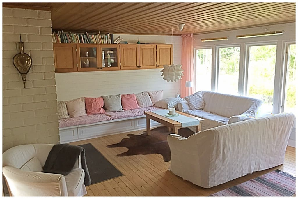Spacious living room. DVDs (which can be played on TV in bedroom) in the top left cabinets and board games and jigsaws under the middle seat.