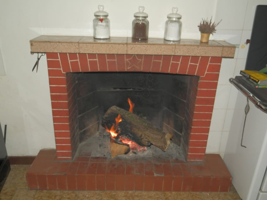 The fireplace in the kitchen.