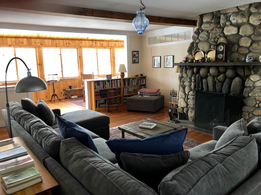 Share drinks & conversation by the stone fireplace