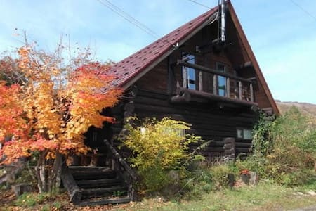 Log House in the hills of the quiet forest
