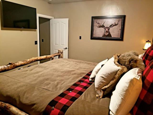 """Master bedroom w/ 50"""" tv"""