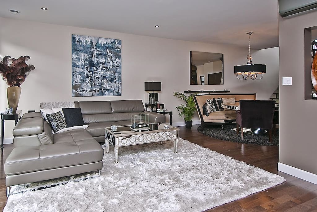 First floor Living room area with a confortable leather sectional.