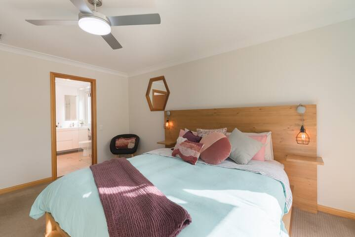 Spacious master suite with luxurious king bed with quality linen, ensuite, walk in robe to balcony.