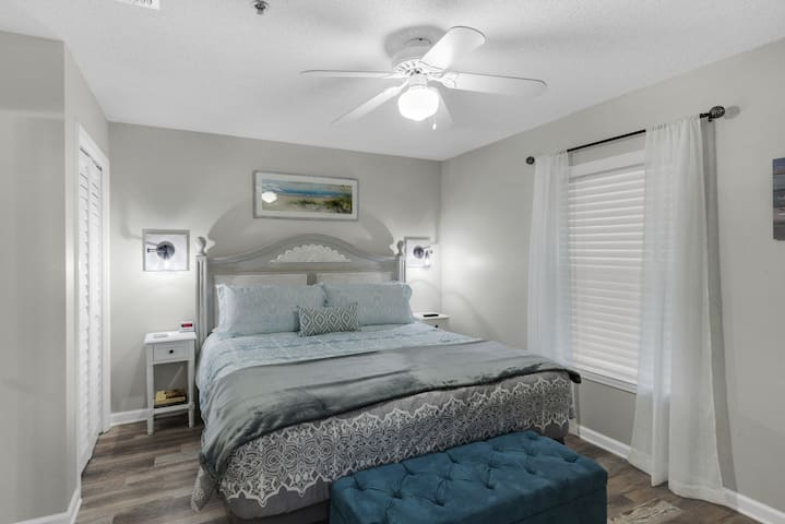 King bedroom, luxury bedding, access to bathroom from bedroom, large TV
