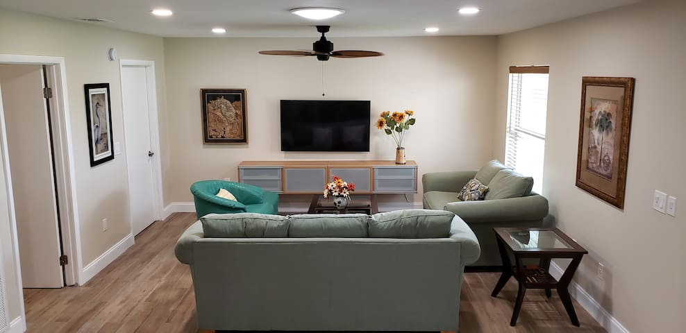 View of living room, this is a Smart TV and  DirectTV Satellite service.