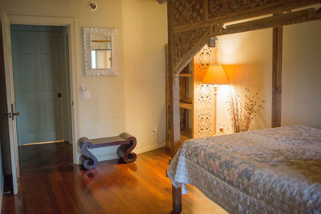 Lumi Leilani – Heavenly Flower Room.  Cozy Queen Bali Canopy bed with private bath.