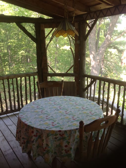 Screened in porch overlooking lake with dining table
