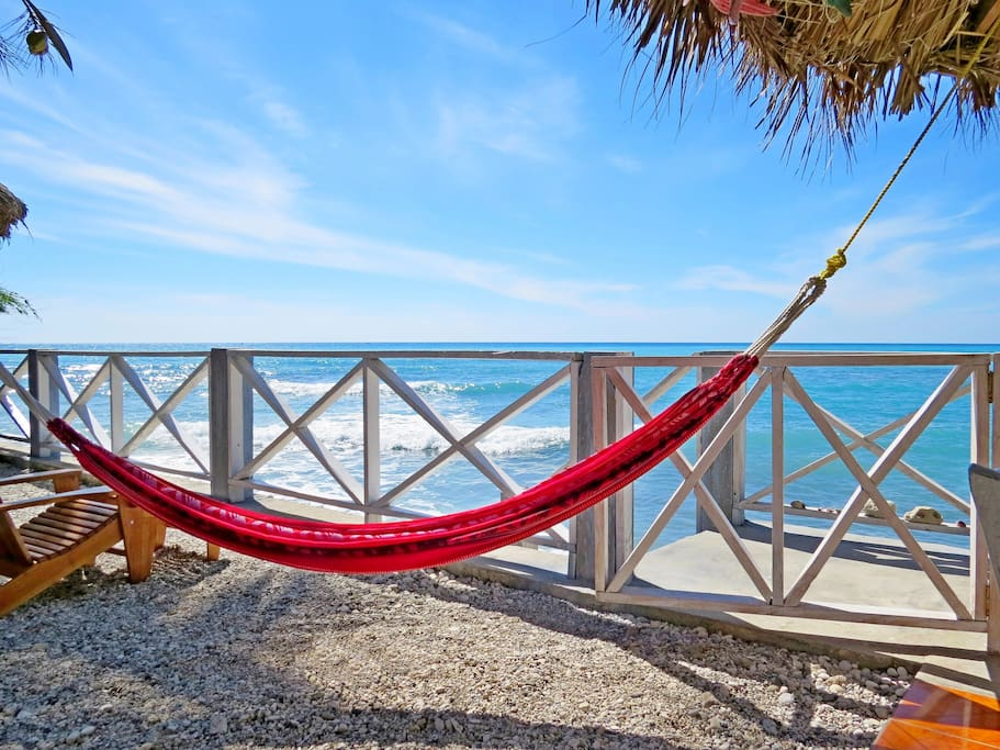 Comfortable Hammocks for your relaxation by the Sea.