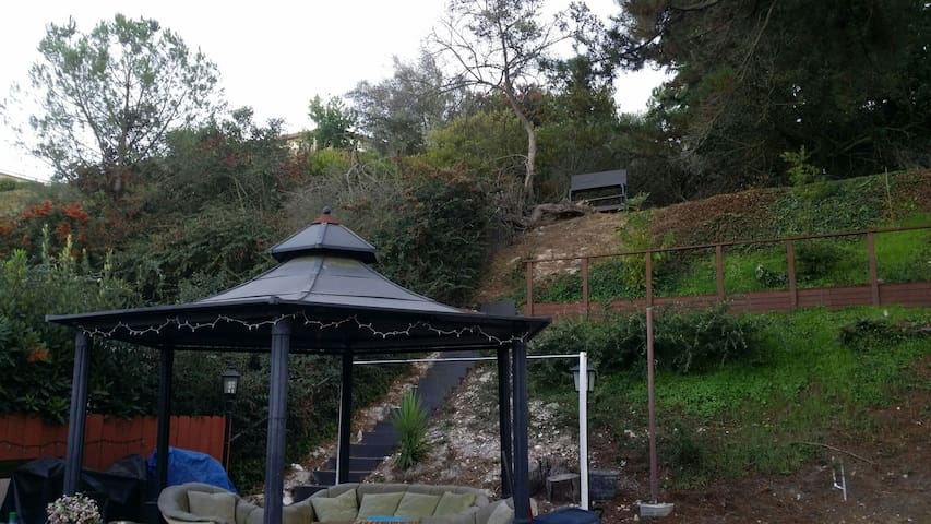 Enjoy the backyard with view of the hill from the Gazebo
