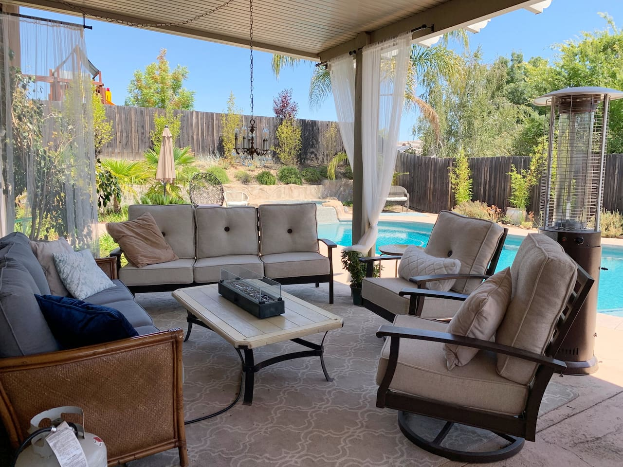 Stunning private outdoor seating area with bbq, pool, hot tub, sunning area and picnic area.