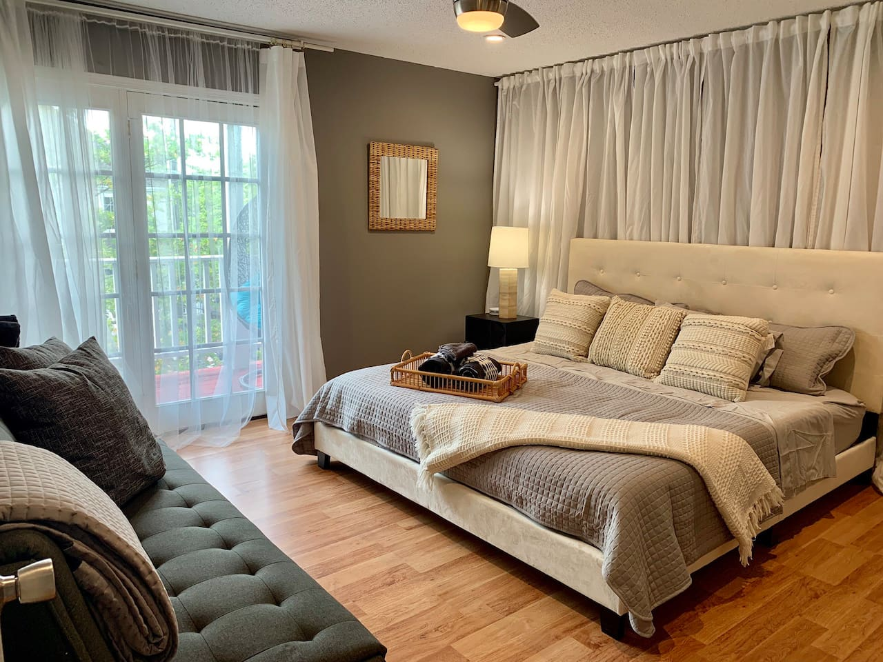 Master bedroom with king memory foam mattress and down alternative mattress topper. Full size futon opens to a bed. Access to private balcony and master bath with a large shower