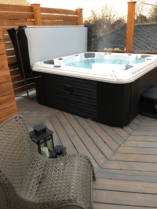The hot tub is steps away from the back door.