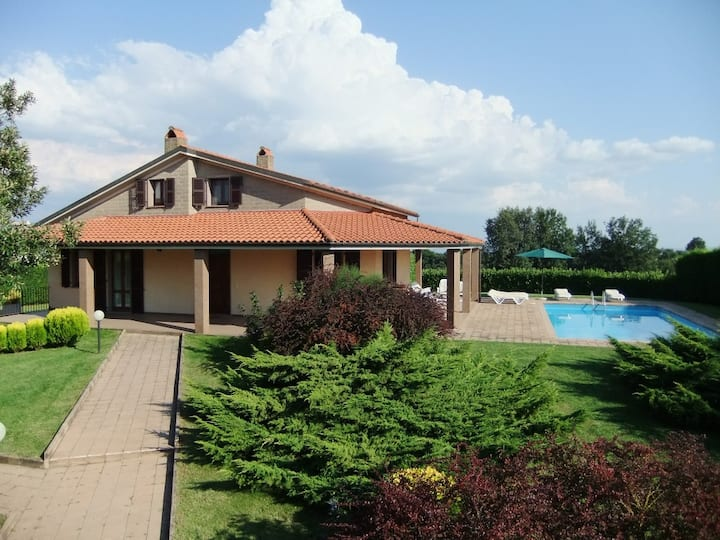 Villa with swimming pool surrounded by the nature