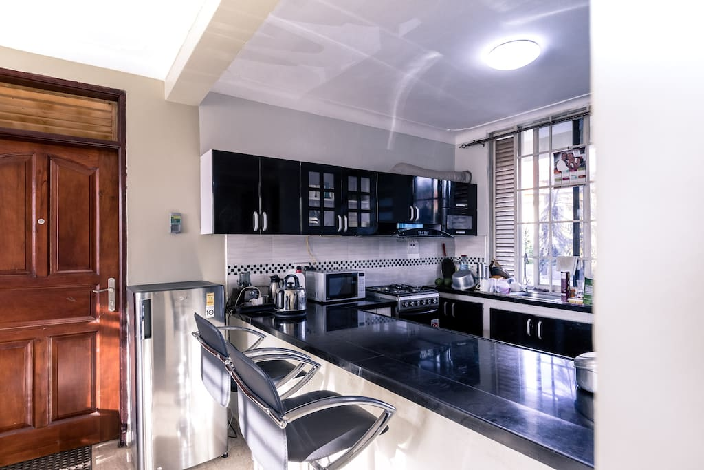 Kitchen: The coolest thing about the kitchen is not that it's wide  and american, It is the multi purpose work top.