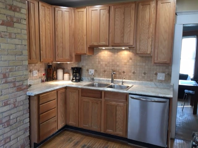 Nice fully equipped kitchen with new stainless appliances, under cabinet lighting and coffee maker.