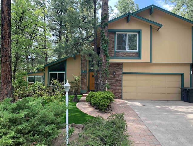 Remodeled mountain home with spa in the pines.