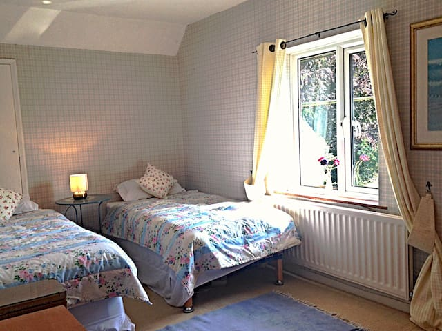 Twin bedded room with views over the fields.