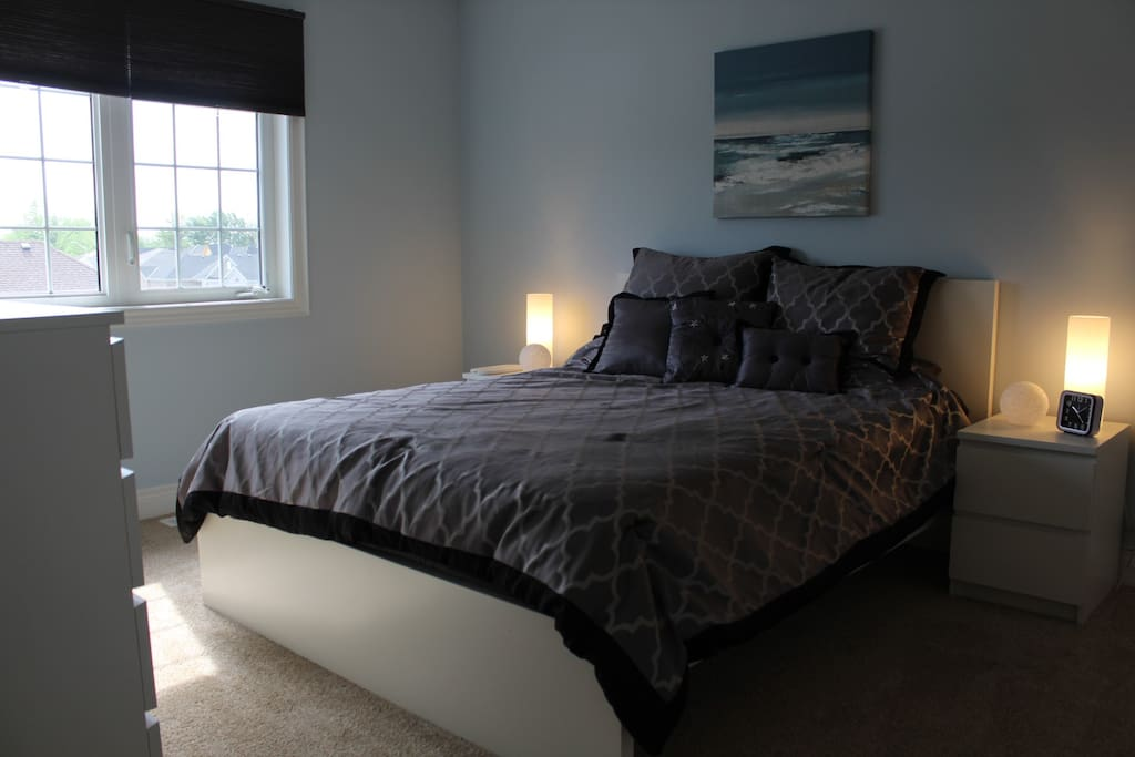 Queen Bed in large, bright upper bedroom in new home