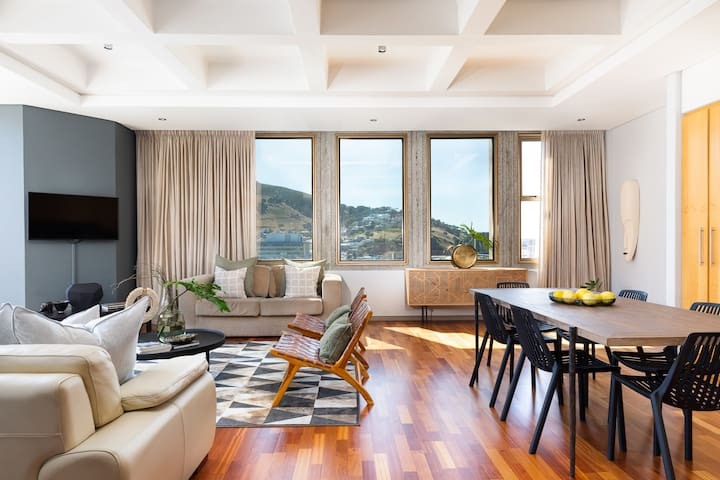 Magnificent light streams into bay windows of this 18th floor apartment