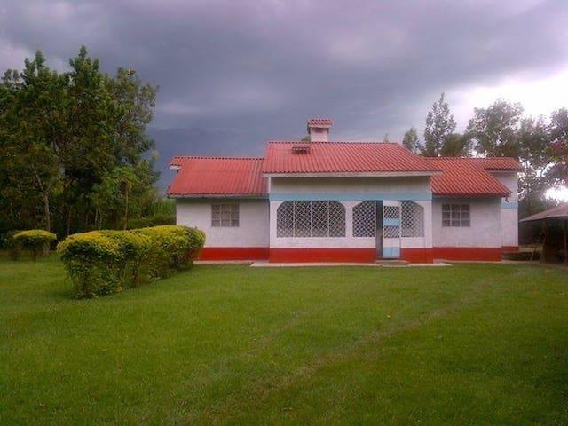 Four bedroom house & big compound