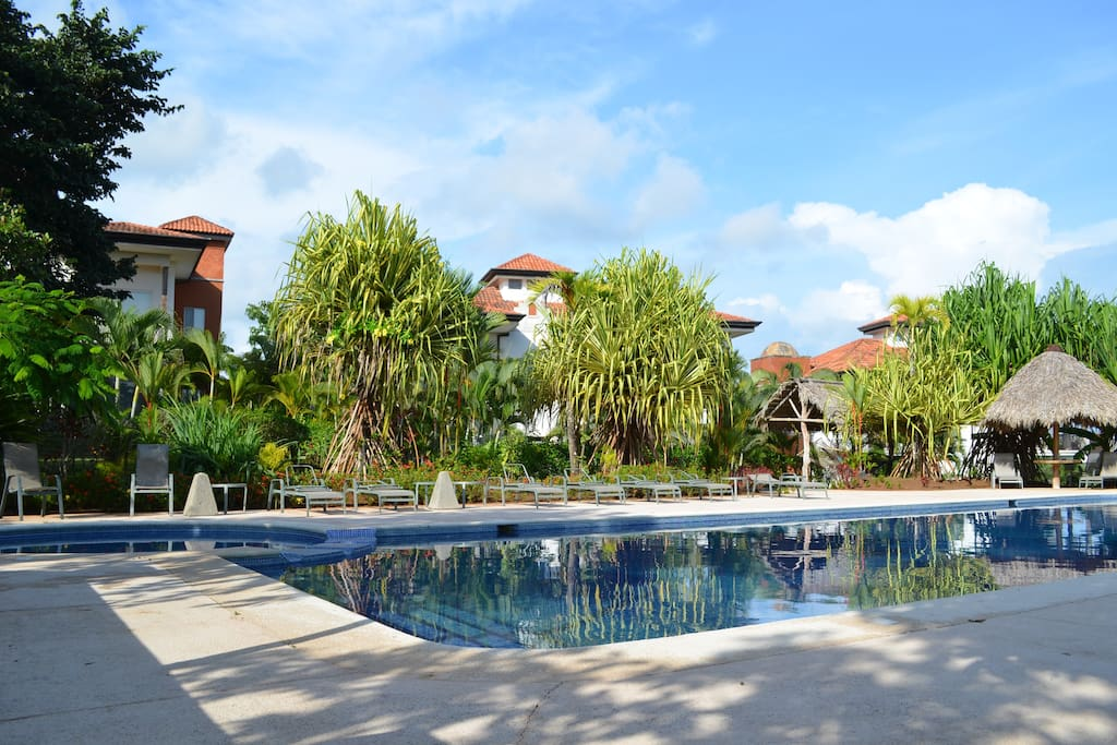 Our condo and your private suite is a stones throw from the beautiful communal pool!