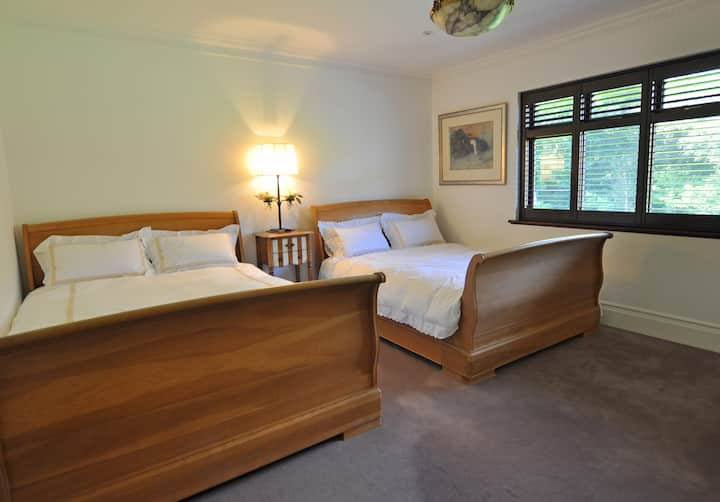 Twin double beds in a luxury home with en-suit