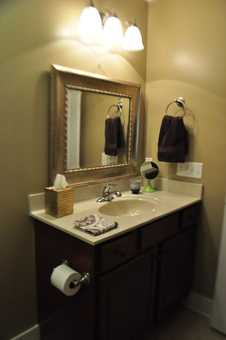 Your private bathroom located just outside your bedroom down a short private hallway.