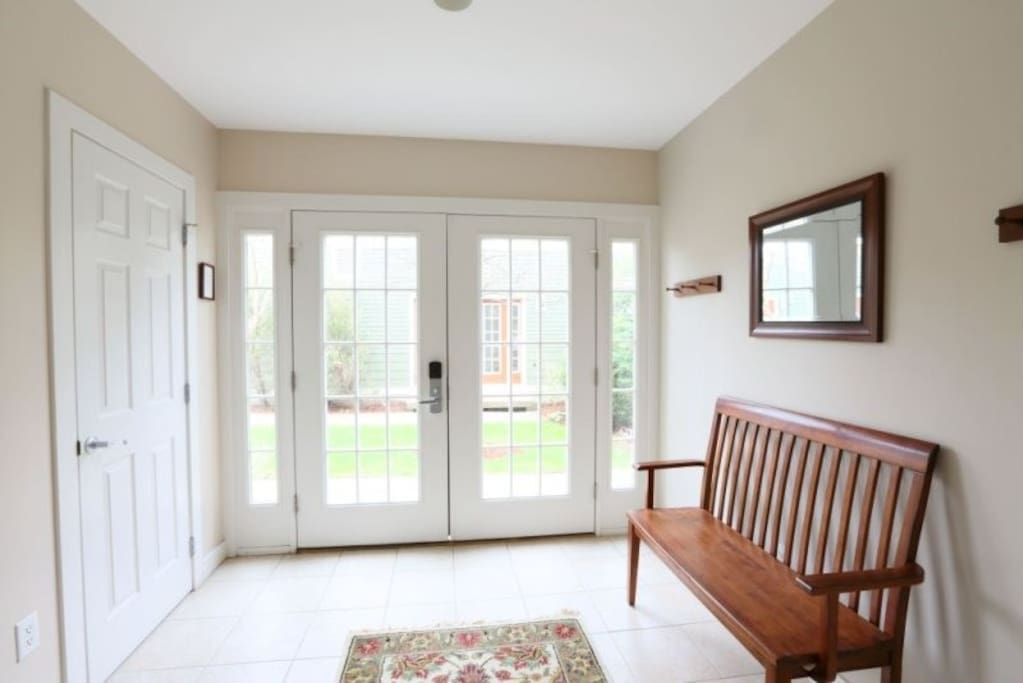 Tiled entry is the perfect place for coats, shoes and boots