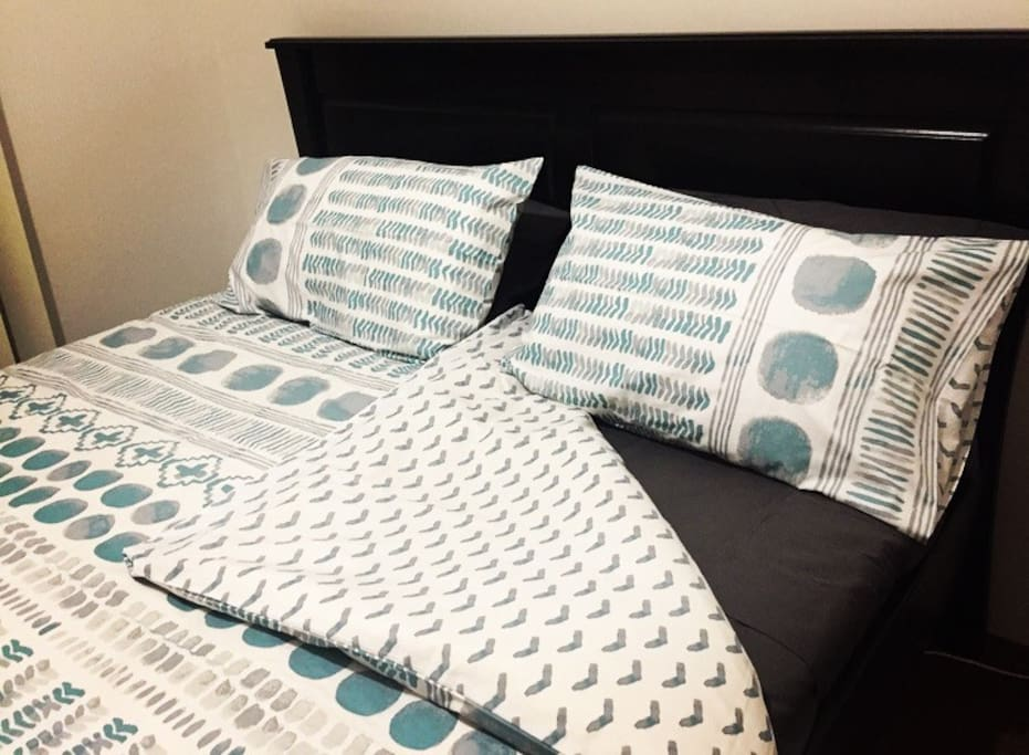 Your bed with brand new sheets, underlay, pillows and doona cover
