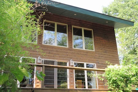 Log cabin retreat on 50 acre farm