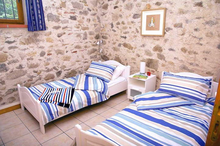 One of two twin bedded rooms, beautifully renovated with original stone walls.