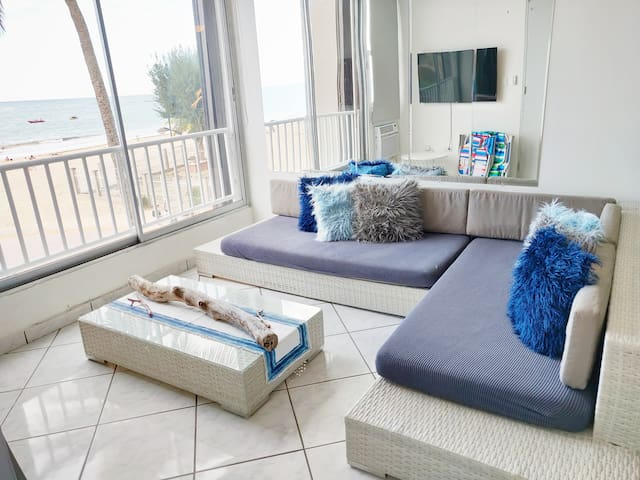 """Living room features a beautiful ocean view. 50"""" HDTV Smart TV. 2 people can sleep in the living room. The couch can be used as 2 twin size beds or can be combined into one queen size mattress if put together."""