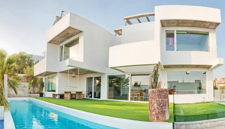 Minimalist family villa with private infinity pool