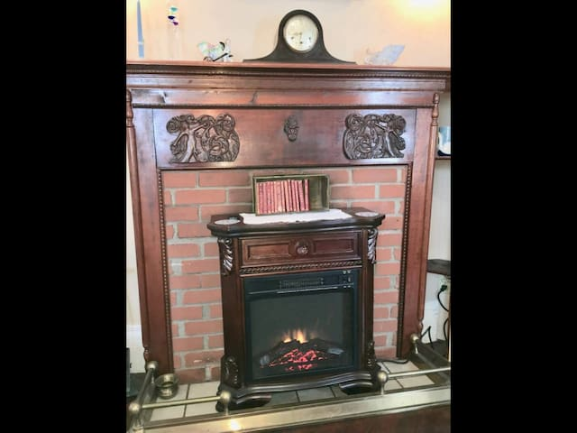 a cozy electric heater insert in antique fireplace