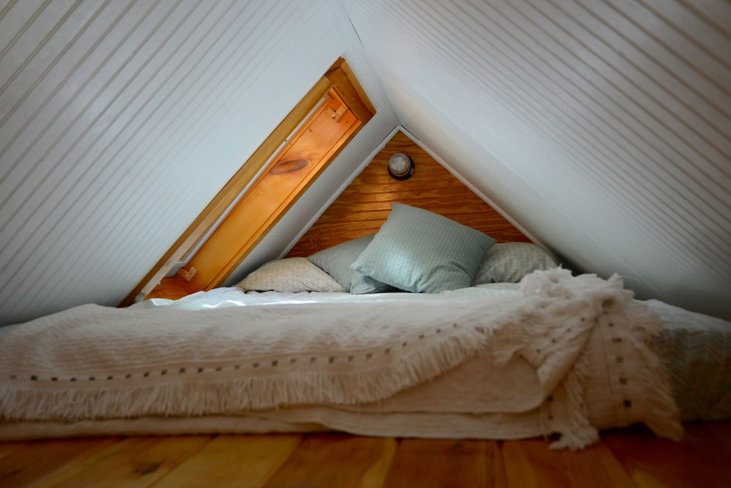 Double bed sleeping loft with skylight overlooking mountains and starry nights
