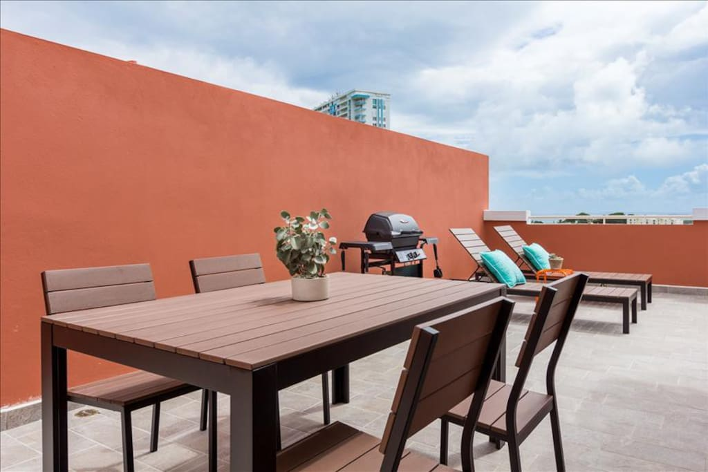 Dining table and grill on the rooftop