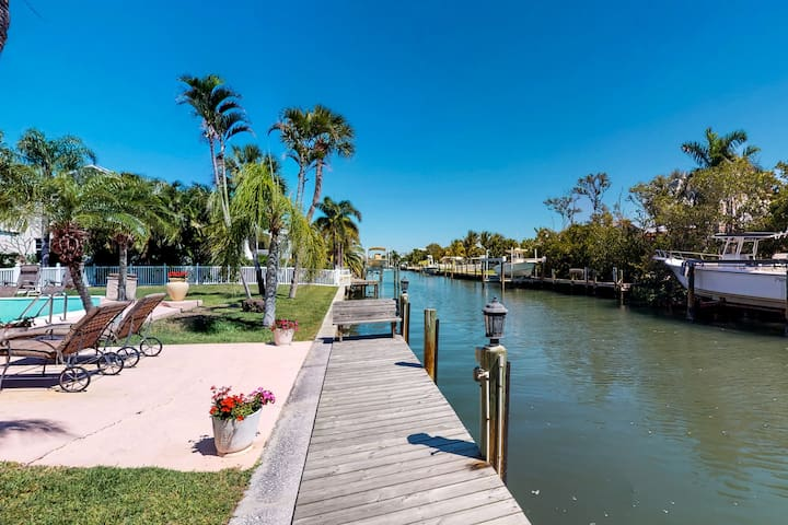 Canal side home with pool and boat dock!