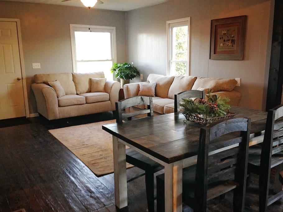 The living room, dining room, and kitchen are all open to one another.