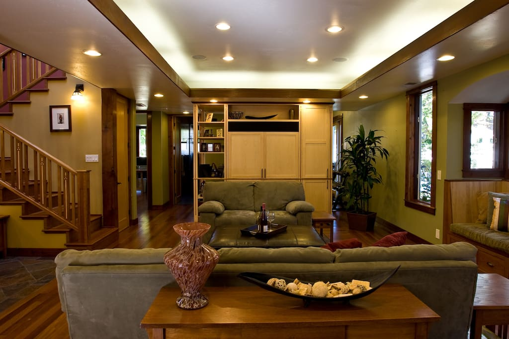 Lighted Soffit and Large Hidden TV with Home Theatre System built into the ceilings