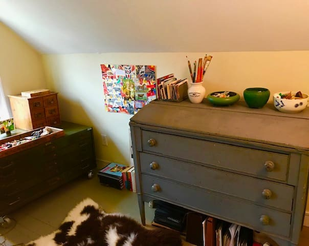 The host's studio is also available for sleeping, amidst half-finished collages, paint brushes, and other art supplies.