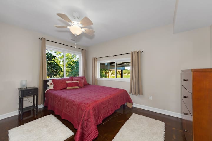 The 2nd bedroom has a queen size bed and dresser with a great view of the pond.  A perfect start to your day!