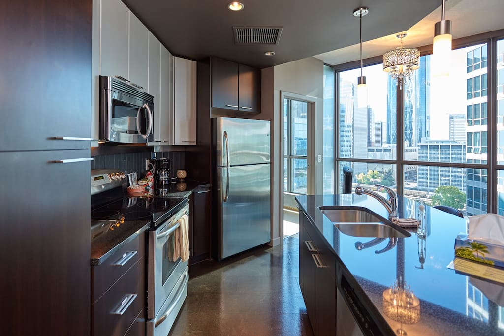 Open concept kitchen with stainless steel appliances.